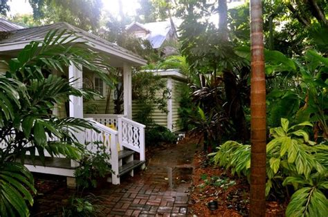 island city house front desk and tropical garden picture of island city house hotel key west