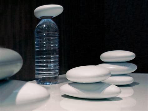 designboom water bottle lookingblog water life pebble bottle opener by arik levy