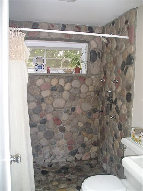 river rock bathroom ideas river rock applied into shower floor also wall and door by using white curtain
