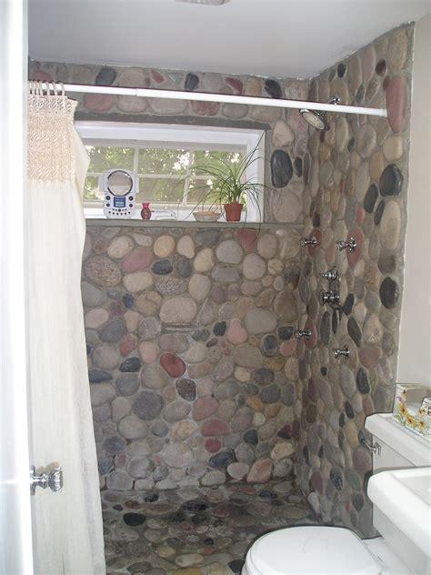 river rock bathroom ideas river rock applied into shower floor also