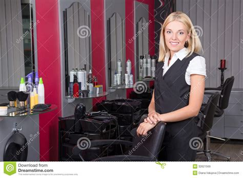 Professional Hair Dresser by Professional Hairdresser In Salon Royalty Free