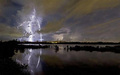 lake night  distance horizon sky lightning rank clouds