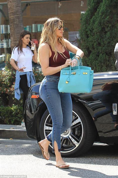green tank and flipflops blue denim jean shorts 6 30 khloe kardashian s derriere on display in skintight denim