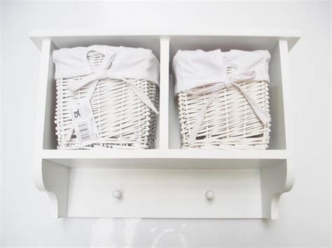 Storage Shelf With Hooks by Small White Wall Shelf With Hooks And Basket Storage