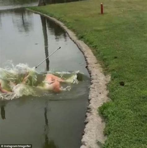 people falling off swings video shows golfer falls backwards into pond after taking
