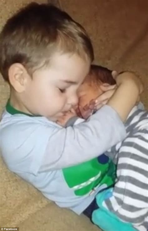 babies holding born to a delighted tennessee boy refuses to give baby brother back to his mom
