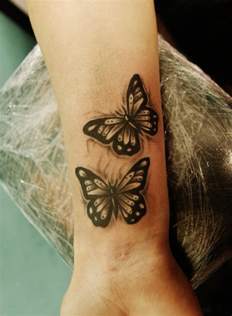 nevermore tattoo wrist butterflies by nevermore ink tattooimages biz