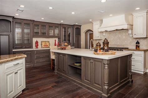 kitchen cabinets with light wood floors countertops