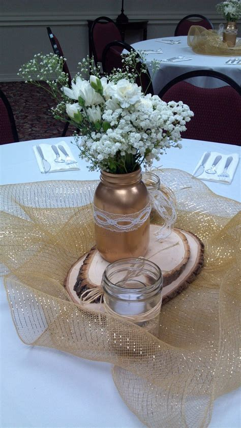 Centerpieces  Gold spray painted mason jars   50th