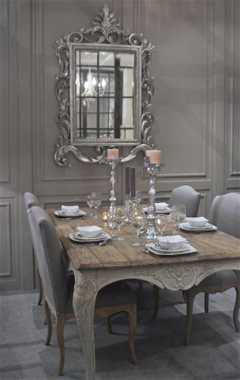charming shabby chic dining room in french grey with an excuisite carved french mirror as art on