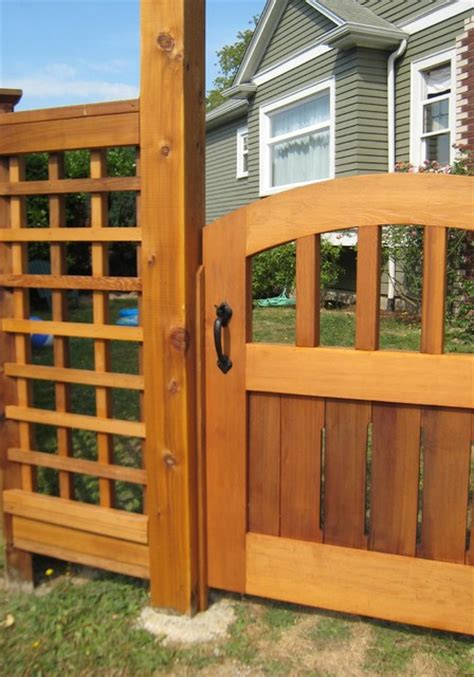 Seattle Kitchen Design exterior view of wood gate with bronze thumb latch
