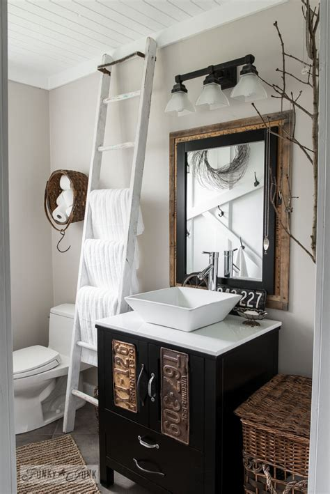 bathroom decorating with old ladder repurposed ladders 80 plus ways to decorate with a