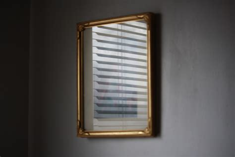 mini blind reflected in picture frame glass picture free