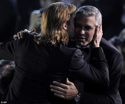 George Clooney Kisses For The Right Price by Critics Choice Awards 2012 Brad Pitt And George Clooney