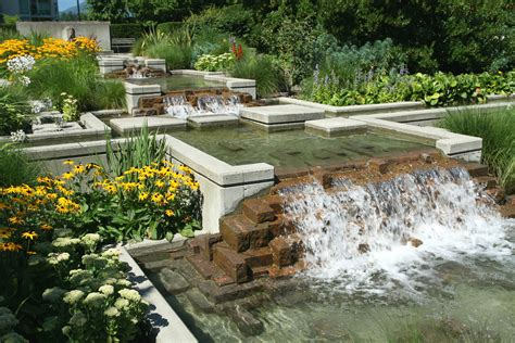 yard features simple landscape design with water features