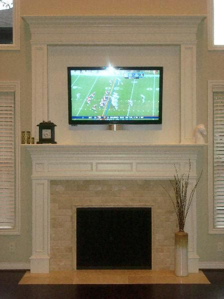 tv above fireplace tv fireplace nance interiors