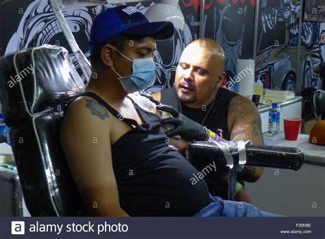 manila tattoo convention 2015 manila philippines 25th sep 2015 a tattoo artist busy