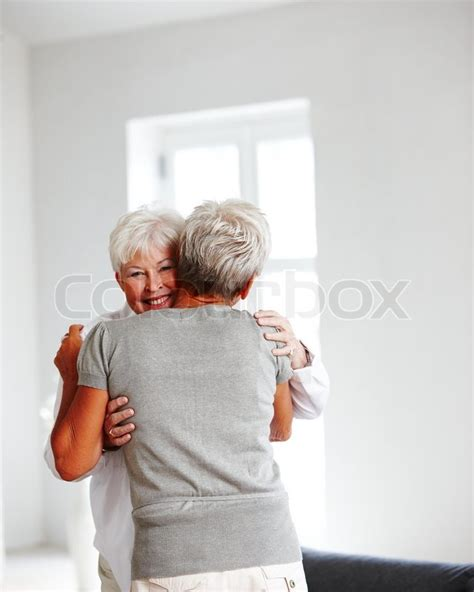 seniors and elders embrace books two elderly caucasian in embrace stock photo
