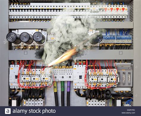 overloaded electrical circuit causing electrical short  fire stock photo  alamy