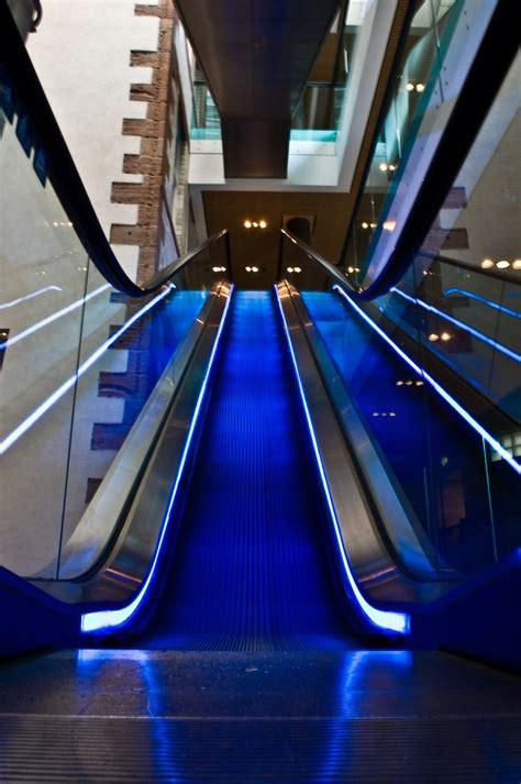 escalator lighting escalator beautiful buildings stairs
