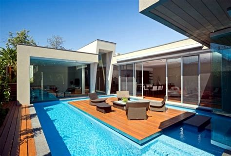 home with pool modern house in canterbury a wooden deck by the pool