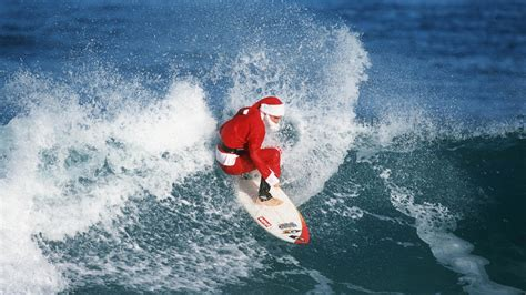 santa on surfboard oahu paddleboarding surf lessons more by rainbow