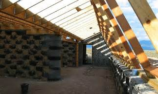 How Much Does It Cost To Build A House In Montana heat your house with car tyres and earth earthship