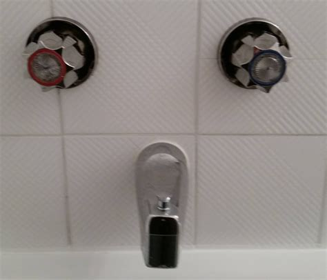Removing Old Kitchen Faucet by Broken Bathtub Faucet Handle