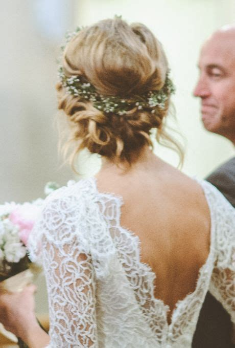 bun hairstyles for evening gowns a purple flower crown featuring ferns lace gowns