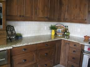 walnut color kitchen cabinets venetian gold granite with a cream beveled subway tile