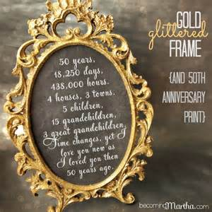 gold and glittered frame and print 50th anniversary party decor