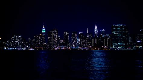 city light and water empire state and chrysler buildings at from across