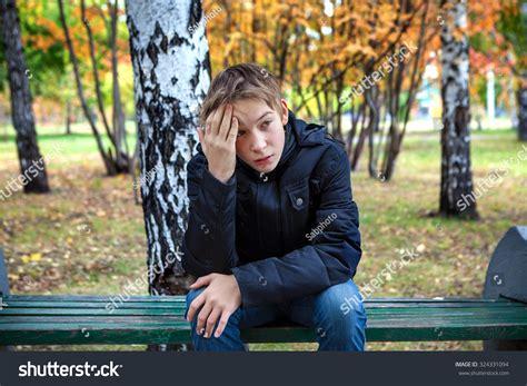 kid on bench stressed kid sit on bench autumn stock photo 324331094