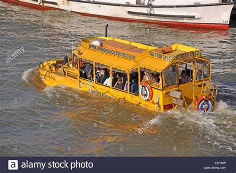river thames yellow boards london duck tours a distinctive yellow hibious tour