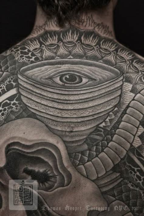 geometric tattoo eye an eye is at the focal point of this thomas hooper