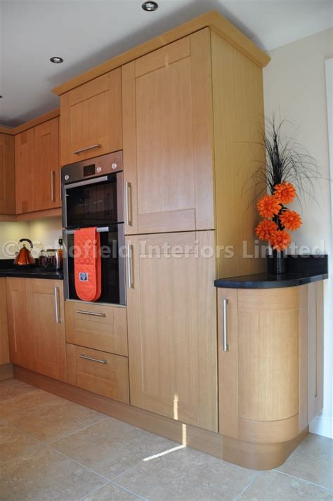 Oak Effect Kitchen Cabinets Stamford Oak Shaker With Black Sparkle Quartz Schofield Interiors Limited