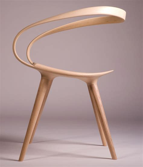 chaise designer the velo chair uses a single piece of bent wood as the