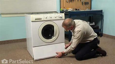 washing machine repair replacing  drain pump