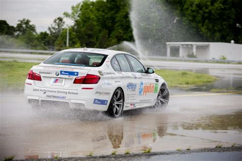 bmw drift bmw m5 drifts 82km to reset world record for charity