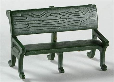 green metal bench green metal park bench
