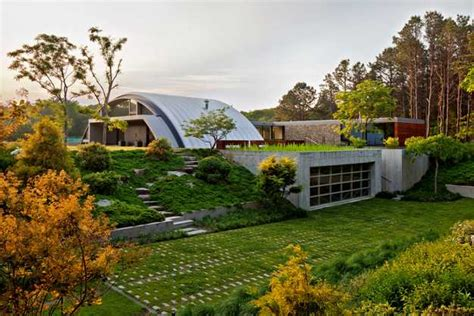 living arc green roofs modern house design with arc roof features eco friendly