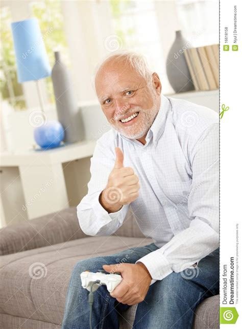 Man On Computer Meme - older man giving thumb up with computer game stock photo