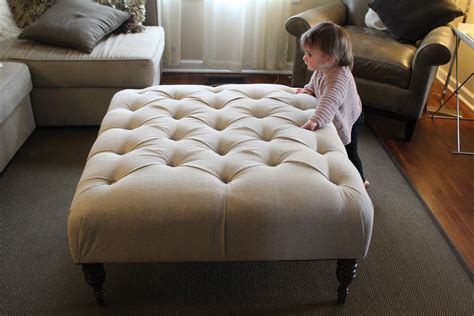 How To Make Tufted Ottoman Large Square Tufted Ottoman Coffee Table With White Upholstered Cover And Wooden Legs On Gray