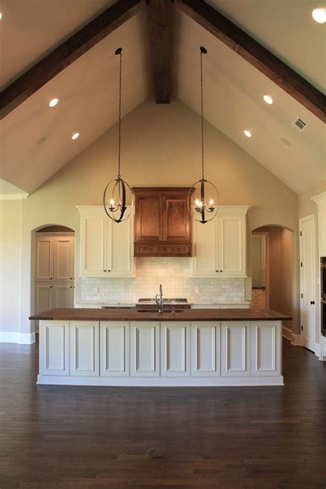 vaulted ceiling wood counter top island in kitchen