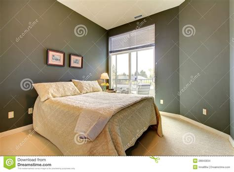white green bedroom bedroom wiht grey green walls and white bedding stock