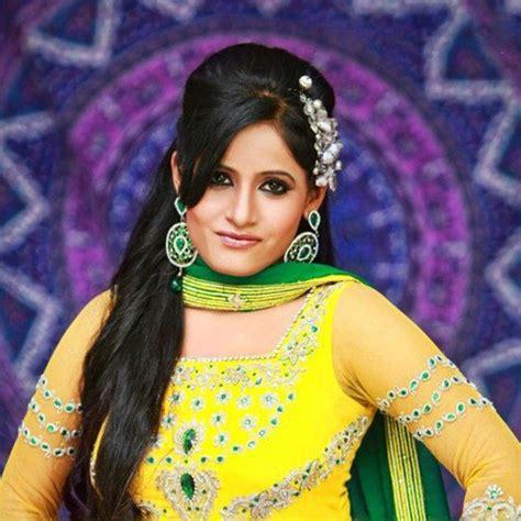 listen to miss pooja songs on saavn