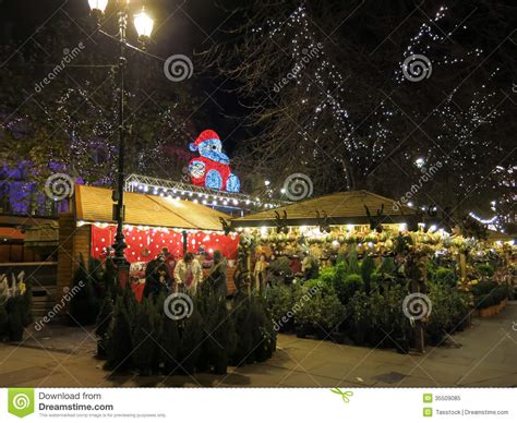 stall with christmas trees at manchester xmas market