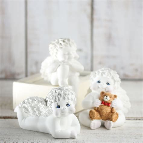 white curly haired white faux curly haired cherub table and shelf sitters home decor