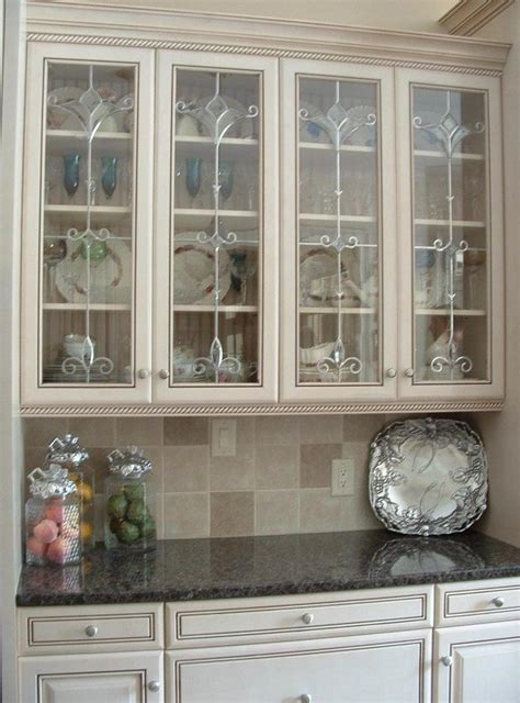 what to display in glass kitchen cabinets ideas on installing the best frosted glass cabinets in