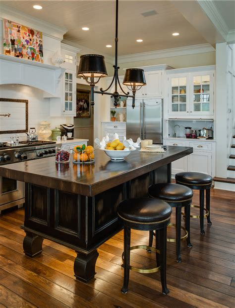 lighting above kitchen island coastal home with traditional interiors home bunch